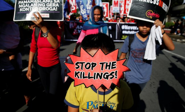 People display placards during a protest against the government of President Rodrigo Duterte on anniversary of the 1972 Martial Law declaration in Manila, in Philippines, September 21, 2018. REUTERS/Eloisa Lopez