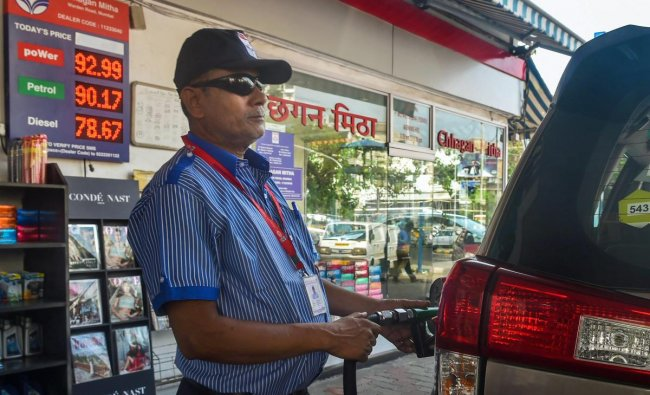 Mumbai: A filling station attendant assists a customer at a fuel station, in Mumbai, Monday, Sept 24, 2018. Petrol on Sept 21, 2018, crossed the Rs 90-mark in Mumbai as a dip in the value of rupee and rise in international oil prices pushed rates across the country to new all-time high. (PTI Photo/Mitesh Bhuvad)