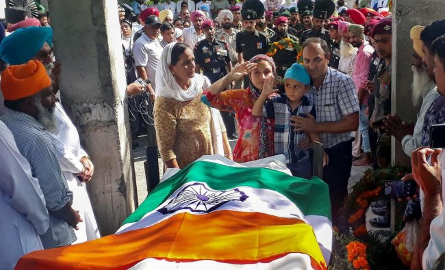 Gurdaspur: Family members pay their last respects to Lance Naik Sandeep Singh during his funeral at Kotla Khurd in Gurdaspur, Punjab, Tuesday, Sep. 25, 2018. Singh was killed Monday in Kupwara (J & K) in an encounter with militants. (PTI Photo)