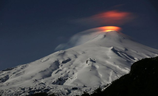 The Villarrica Volcano is seen at night from Pucon town, Chile, September 24, 2018. Picture taken September 24, 2018. REUTERS/Cristobal Saavedra Escobar