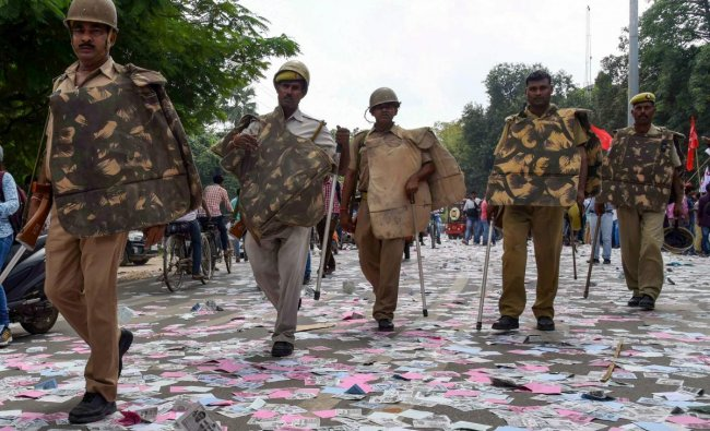 Allahabad: Police arrive to control the situation after a clash between two students\' groups during nomination filing for Allahabad University Students elections, in Allahabad, Wednesday, Sept 26, 2018. (PTI Photo)