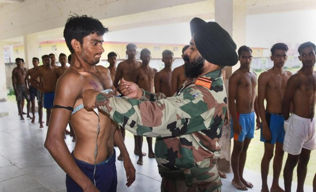 Patna: An officer takes measurements of an aspirant during an army recruitment, at Danapur near Patna, Wednesday, Sept 26, 2018. (PTI Photo)