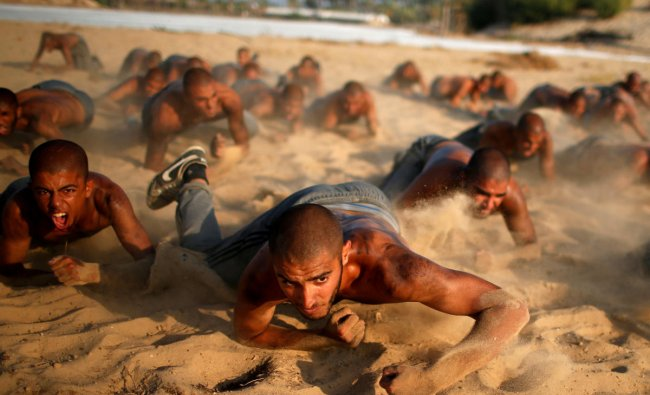 Palestinian cadets crawl as they demonstrate their skills at a police college run by the Hamas-led interior ministry, in Khan Younis in the southern Gaza Strip, September 26, 2018. REUTERS/Mohammed Salem