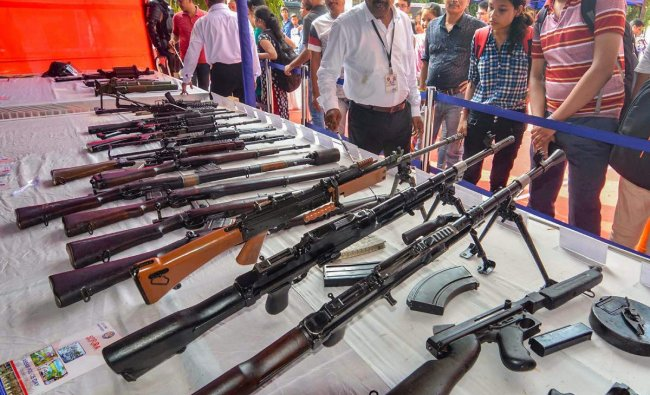 Students visit an arms stall during an exhibition to commemorate Assam Police Day, in Guwahati, Friday, Sept 28, 2018. (PTI Photo)