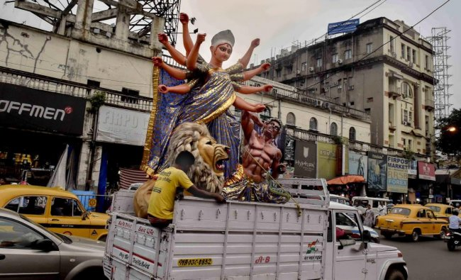 An idol of Goddess Durga is taken to a pandal for the installation ahead of Durga Puja festival in Kolkata. (PTI Photo)