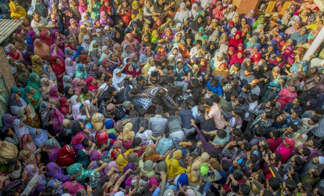Srinagar: People gather around the body of Mohammad Salim Malik, during his funeral procession in Noorbagh area of Srinagar, Thursday, September 27, 2018. Malik, a civilian, was killed during a search operation in Srinagar. ( PTI Photo/S Irfan)