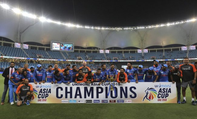 Indian players and team support staff celebrate with the trophy after winning the Asia Cup final cricket match against Bangladesh, in Dubai. (AP/PTI Photo)