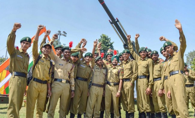 NCC cadets pose for photos during an event to commemorate \'Parakram Parv\', in Jabalpur. (PTI Photo)