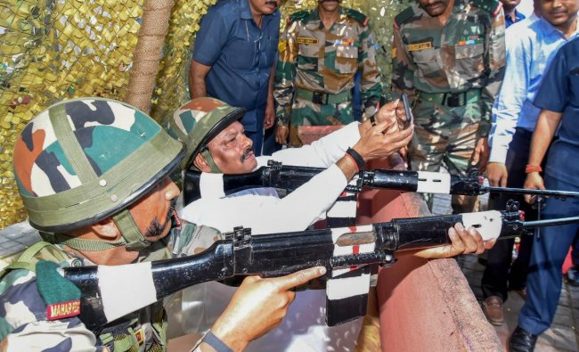 Jharkhand Chief Minister Raghubar Das takes selfie as he experiences an army weapon to commemorate \'Parakram Parv\' at the Dipatoli War Memorial, in Ranchi. (PTI Photo)