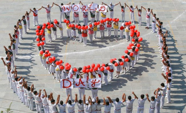 Students stand in a heart formation to commemorate World Heart Day, in Jammu. (PTI Photo)