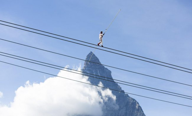 Tightrope walker Freddy Nock, walks in front of the Matterhorn mountain during the inauguration ceremony for the new 3S cablecar in Zermatt, Switzerland. (AP/PTI Photo)