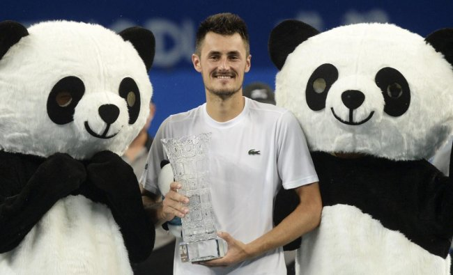 Bernard Tomic of Australia poses with his winning trophy after defeating Fabio Fognini of Italy in the men\'s singles final of the ATP Chengdu Open tennis tournament in Chengdu in China\'s southwest Sichuan province, Sunday, Sept. 30, 2018. (AP/PTI Photo)