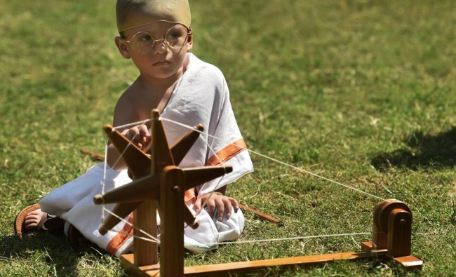 A student of a pre-school, dressed up as Mahatma Gandhi, participates in a function organised by Gujarat Vidyapith to celebrate \'Gandhi Jayanti\', in Ahmedabad, Monday, October 1, 2018. (PTI Photo)