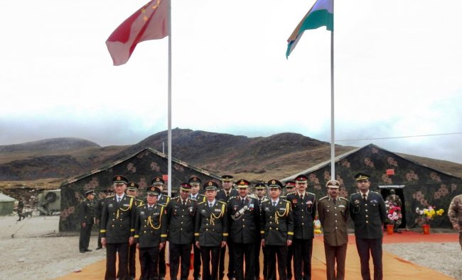 Indian and Chinese army officers exchange before a meeting on the occasion of National Day of China, at Bumla, the Line of Actual Control (LAC), Monday, Oct 1, 2018. (PTI Photo)
