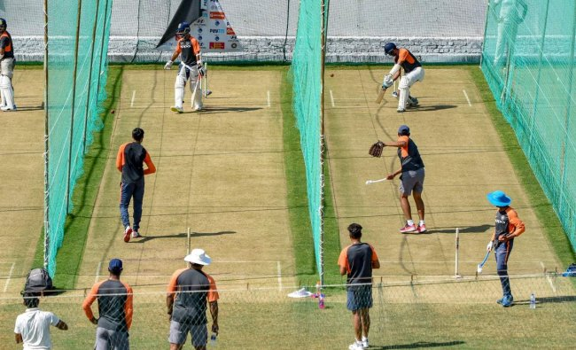 Indian cricket team practice ahead of their first match in the India-West Indies test series, in Rajkot. (PTI Photo)