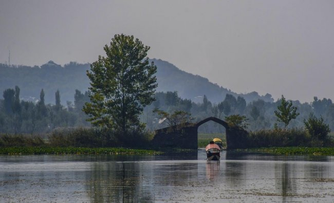 A view of the 17th century Mughal-era camel hump shaped bridge 'Oonth Kadal', situated in the middle of the famous Dal Lake in Srinagar. (PTI Photo)