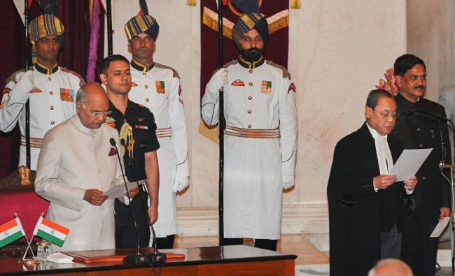 President Ram Nath Kovind administers oath of office to Justice Ranjan Gogoi after he was appointed as the 46th Chief Justice of India, at Rashtrapati Bhawan in New Delhi, Wednesday, Oct 3, 2018. (PTI Photo)