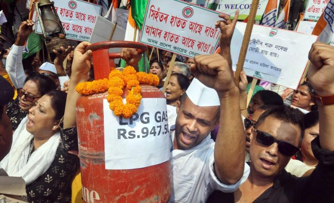 Assam Pradesh Congress Committee (APCC) activists raise slogans in protest against the Central government for hike in fuel prices, in Guwahati, Wednesday, Oct 3, 2018. (PTI Photo)