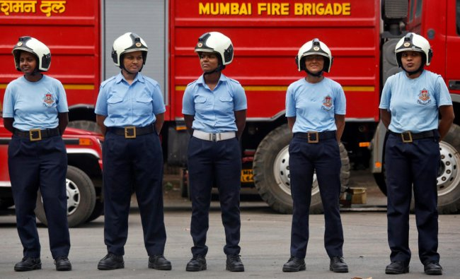 Female firefighters stand in a line during a drill at a fire station in Mumbai. (Reuters Photo)