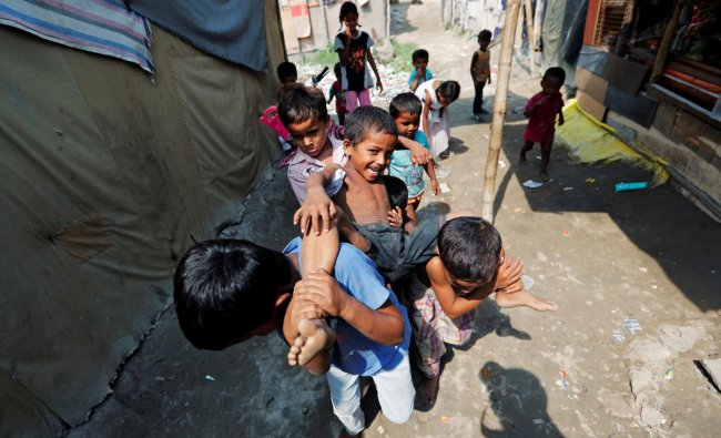 Children from the Rohingya community play outside their shacks in a camp in New Delhi. (Reuters Photo)