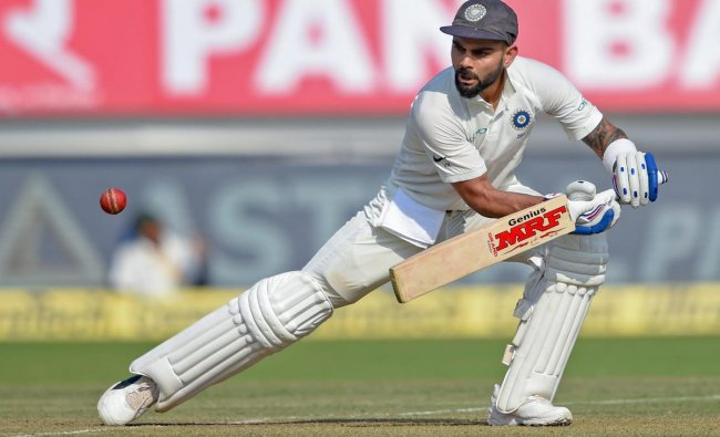 Virat Kohli plays a shot during the first test cricket match played between India and West Indies, in Rajkot. (PTI Photo)