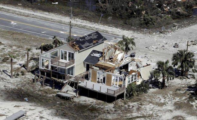Homes destroyed by Hurricane Michael are shown in this aerial photo in Mexico Beach, Fla. The devastation inflicted by Hurricane Michael came into focus Thursday with rows upon rows of homes found smashed to pieces, and rescue crews began making their way into the stricken areas in hopes of accounting for hundreds of people who may have stayed behind. AP/PTI