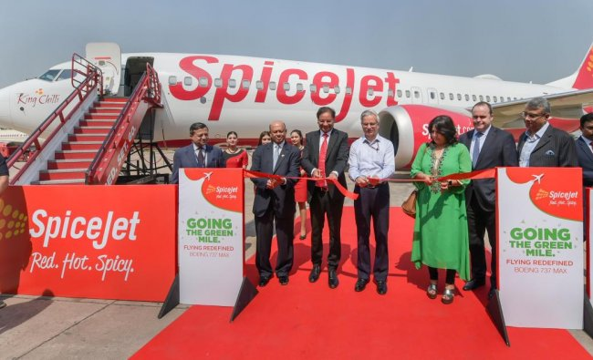 Civil Aviation Secretary Rajiv Nayan Choubey (C), SpiceJet CEO Ajay Singh, Boeing Sr Vice President Dinesh Keskar and others unveil Boeing 737 MAX-8 aircraft, at IGI airport T2 in New Delhi.