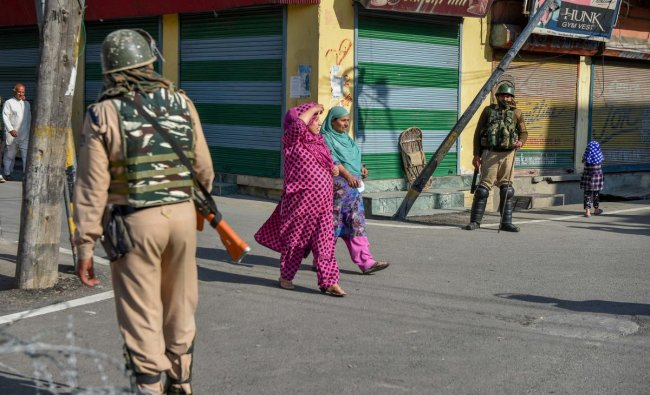 Security personnel stands guard during restrictions and strike called by separatists after the killing of PhD scholar-turned-Hizbul Mujahideen commander Manaan Bashir Wani in an encounter with security forces, in Srinagar. PTI