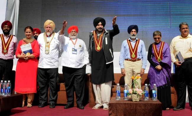 Punjab Local Bodies Minister Navjot Singh Sidhu, Bollywood actor Deepa Sahi, ITC Hotels Corporate Chef Manjit Singh Gill with other chefs during \'World heritage cuisine summit & food festival 2018\', in Amritsar. PTI
