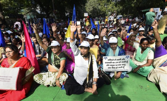 Women participate in \'Baatein Aman Ki\' campaign led by Women for Peace, at Jantar Mantar, in New Delhi. PTI