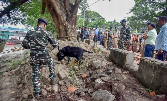 Army personnel inspect the site of a low-intensity bomb blast that took place at Panbazar in Guwahati. PTI