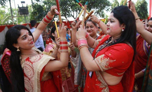 School teachers perform \'Dandiya\' dance during Navratri festival celebrations in Jammu. PTI