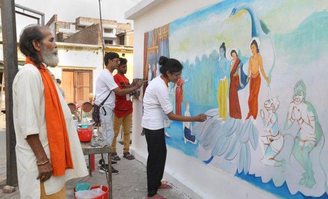 Artists make a wall graffiti on the life of Lord Rama, ahead of Ram Navami festival in Ayodhya. PTI