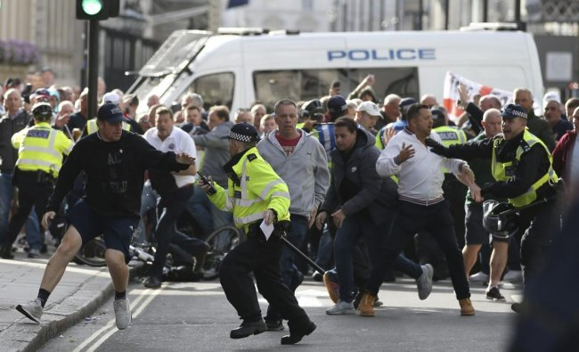 Police stop a breakaway from the main Football Lads alliance march, as they attempt to get close to a rival anti-facist demonstration in London. AP/PTI