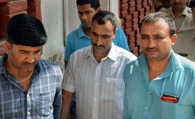 Police take Mahipal, who was accused of shooting the judge\'s wife and son, to a court, in Gurugram. PTI