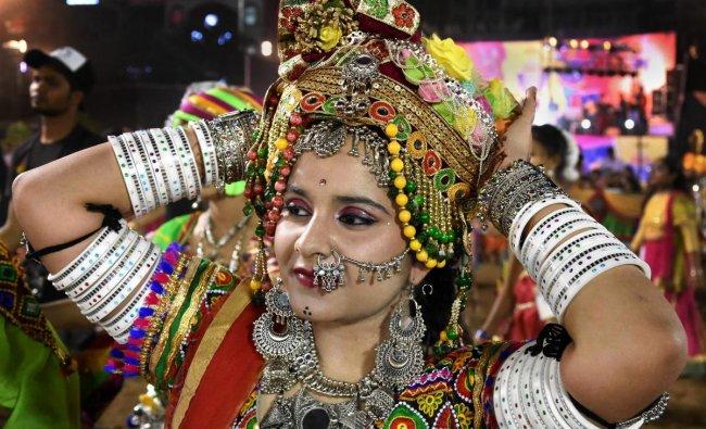 A devotee participates in a Garba dance performance during the Navratri festival celebrations, in Bhopal. PTI
