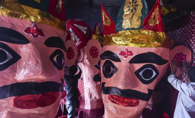 Artisans prepare effigies of demon-king Ravana at a workshop, ahead of Dussehra festival celebrations, in Ahmedabad. PTI