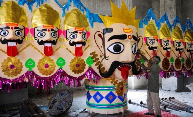An artist works on an effigy of demon-king Ravana, ahead of Dussehra festival in Amritsar. PTI