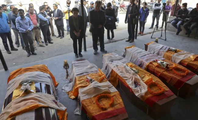 Friends and relatives stand near coffins containing bodies of South Korean climbers killed over the weekend in a fierce storm on Nepal\'s Gurja Himal mountain after they were brought to the Tribhuvan University Teaching Hospital in Kathmandu. The bodies were driven to the airport and were set to be flown to Seoul, South Korea\'s capital, later Tuesday. The bodies of five South Korean climbers are heading home amid calls to improve weather warning systems on Nepal\'s mountains. AP/PTI