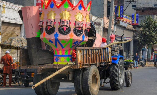 An effigy of demon-king Ravana being carried on a tractor trolley for installation, ahead of Dussehra festival, in Amritsar. PTI