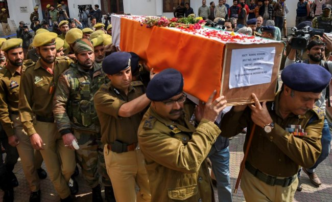 Senior Police officers carry the coffin of their colleague constable Kamal Kishore, who was killed in an encounter with militants at Fateh Kadal, during wreath-laying ceremony, in Srinagar. A policeman of Special Opration Group (SOG) three militants including a over ground worker (OGW) were killed in the gun battle. PTI