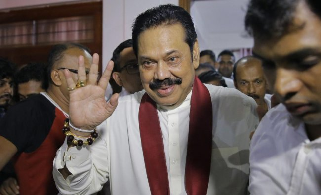 Newly appointed Sri Lankan Prime Minister Mahinda Rajapaksa, center, leaves a Buddhist temple after meeting his supporters in Colombo, Sri Lanka, Friday, Oct. 26, 2018. Sri Lankan President Maithripala Sirisena has sacked the country\'s prime minister and replaced him with a former strongman, state television said Friday. AP/PTI