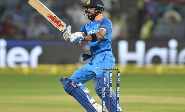 Virat Kohli plays a shot during the third one day international (ODI) cricket match between India and West Indies at the Maharashtra Cricket Association Stadium in Pune on October 27, 2018. (Photo by PUNIT PARANJPE / AFP)