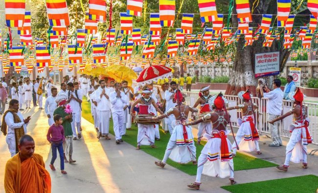 Sri Lankan devotees participate in a procession on the occasion of Kathina Robe offering ceremony, in Bodh Gaya, Sunday, Oct 28, 2018. (PTI Photo)