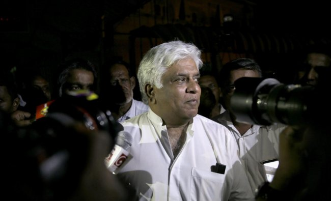 Former Sri Lankan petroleum minister Arjuna Ranatunga leaves a magistrate court after receiving bail in Colombo, Sri Lanka, Monday, Oct. 29, 2018. On Monday, police arrested Ranatunga, a cricketer-turned politician, in connection with a shooting Sunday at the Petroleum Ministry, the first violence related to the islands' political turmoil.AP/PTI