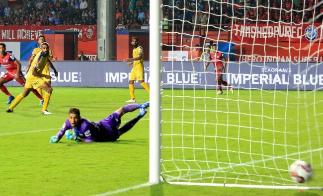 Jamshedpur FC players (red) during a match against Kerala Blasters Football Club players (yellow) in the Indian Super League (ISL) football match 2018, at JRD Tata Sport Complex in Jamshedpur, Monday, Oct 29, 2018. (PTI Photo)