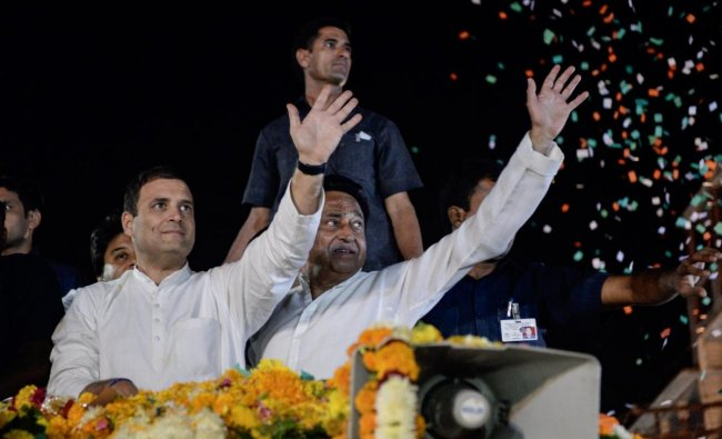 Congress President Rahul Gandhi with party\'s state president Kamal Nath greet their supporters during a roadshow, in Indore, Monday, Oct 29, 2018. (PTI Photo)