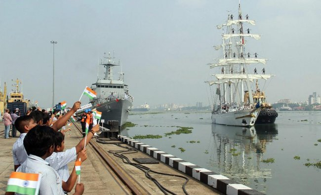 School children wave the Indian tricolour to welcome INS Tarangini which returned to Southern Naval Command, in Kochi, Tuesday, Oct 30, 2018. (PTI Photo)