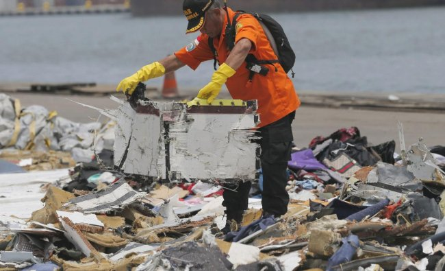 A rescuer inspects parts of Lion Air Flight 610 retrieved from the waters off Tanjung Priok Port in Jakarta, Indonesia, Wednesday, Oct. 31, 2018. A massive search effort identified the possible seabed location of the crashed Lion Air jet, Indonesia\'s military chief said Wednesday, as experts carried out the grim task of identifying dozens of body parts recovered from a 15-nautical-mile-wide search area. AP/PTI