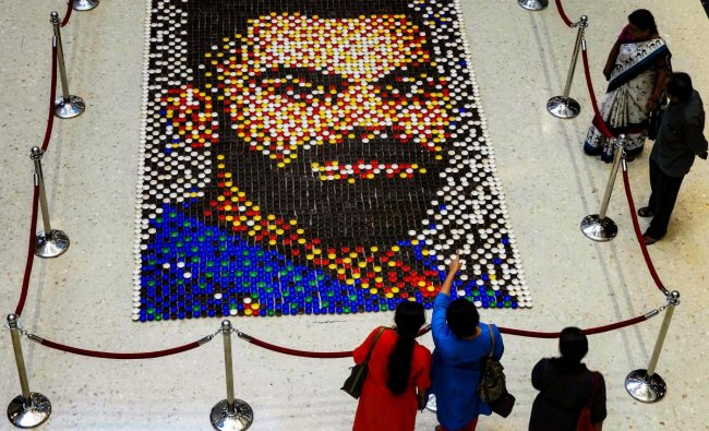 A diya mosaic created by artist Abaasaheb Shewale forming a portrait of Indian cricketer Virat Kohli ahead of his birthday, at a mall, in Mumbai, Tuesday, Oct 30, 2018. (PTI Photo)